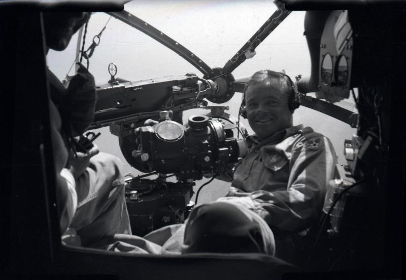 E.G. Hanes with his Norden bomb site in the nose of a B-26