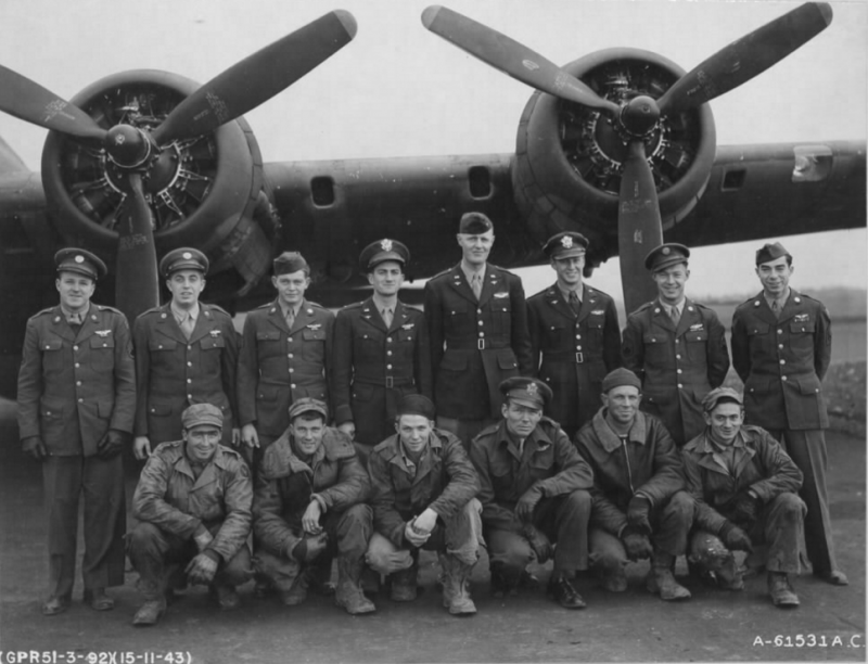 """Caption : """"Lt. Thornton and crew of the 92nd Bomb Group beside a Boeing B-17 """"Flying Fortress"""". England, 15 November 1943."""" (Official USAAF photo).  Note : Lt Thornton was shot down with his crew on the following day's mission to Knaben, Norway on board B-17 """"Flagship"""" # 42-29996 - Lt Thornton is standing, 5th from left top row and the only other identifiable man is Right Waist Gunner S/Sgt Otto F. Trammer, 2nd from left top row.   The others are most probably Co-Pilot 2nd Lt Whitney M. Bray; Navigator 2nd Lt David C. Besbris; Bombardier 2nd Lt Arthur A. Carmell; Top Turret Gunner S/Sgt John Geegee; Radio Operator T/Sgt Laurence E. Dennis; Ball Turret Gunner S/Sgt Dean M. Sommers; Left Waist Gunner S/Sgt Charles H. Hartnett; Tail Gunner S/Sgt Rolland A. Galloway.  Four others are members of the ground crew. S/Sgt Dean Sommers 1st from left top row.  T/Sgt Laurence Dennis 1st on right, top row"""