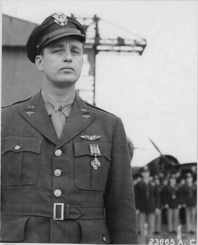 Lt. Col. Elliott Roosevelt receives the Distinguished Flying Cross in Algiers for outstanding services performed by his Group in the African Campaign. [Note B-17E 41-9045 stands in the background]  NARA Ref 342-FH-3A28689-23665AC.