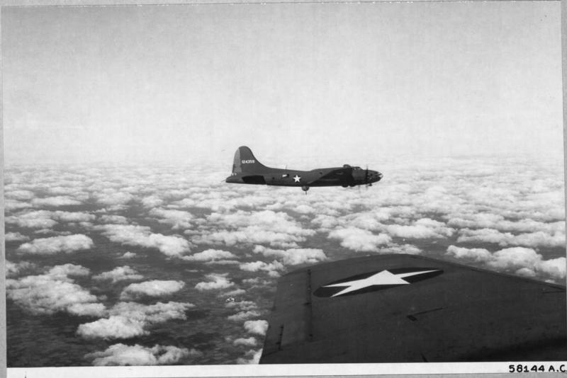 Boeing B-17 Flying Fortresses enroute to bomb enemy installations in Germany.  NARA Ref 342-FH-3A19760-58144AC.   41-24359 was a 301st Bomb Group original flown overseas by Lt Bill Broderick. It was left in England when the 301st moved to North Africa.