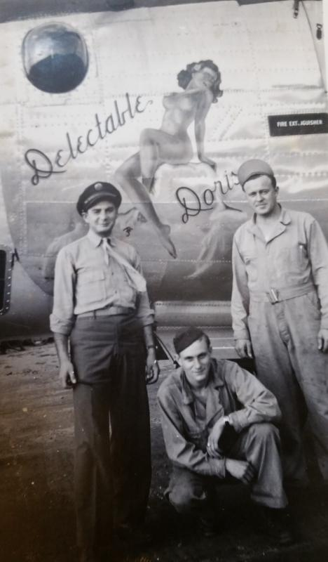 (Doris and dad). James W Braa with B-24  42-50551 and other crew.