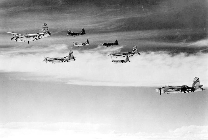 Photo taken by Earl C Fox 397BG's photographer from 42-96181 'Draggin Lady' 26-Jul-44. The flight in the distance is flight A box 2 and comprised 42-96139 [Lead], 42-96124 'Holy Moses' far right, 42-96123 'Baby Butch' far left and 42-96172. The near flight, flight C box 2 and comprises 42-96182 'Miss Furie'[Lead], 42-96176 'Lily from Picadilly', 42-96283 and 42-96289.