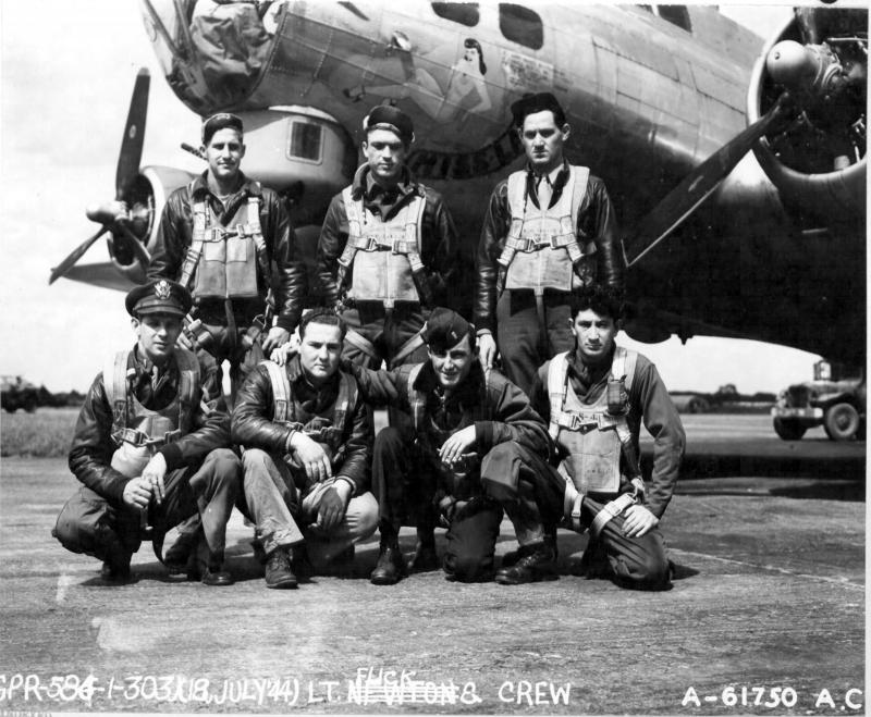 Lt Chester E Flick and crew of the 303rd Bomb Group beside Boeing B-17