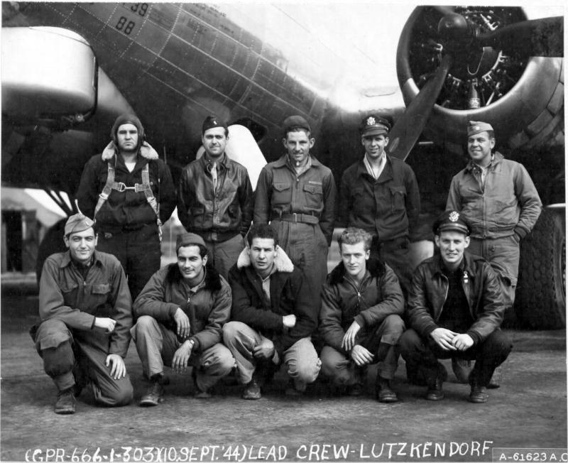 Lead crew of bombing mission to Lutzkendorf, Germany, pose in front of Boeing B-17 Flying Fortress 44-8137. 359th Bomb Squadron, 303rd Bomb Group, England. 10 September 1944. Pilot Colonel Richard H Cole.