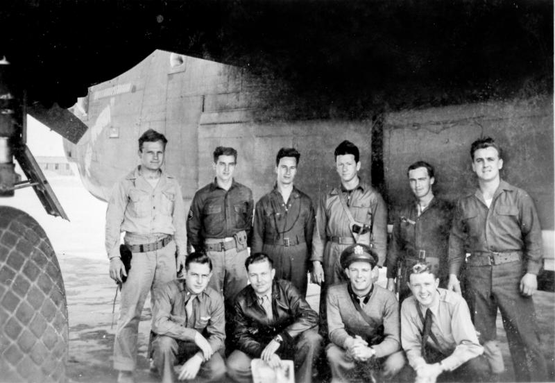crew photo, date and location unknown.  Arthur Aull is kneeling, front, left.