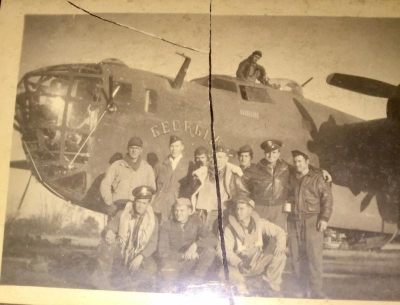 Crew of the 93rd Bomb Group in front of B-24 42-40985 'Georgia Peach'.  Durward Headley, navigator, is kneeling in the middle of the front row.