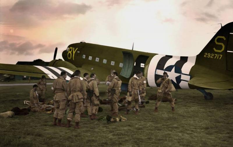 Airborne troopers of the 506th PIR prepare for their flight to Normandy. The C-47 to carry them was flown by the CO of the 440th Troop Carrier Group. C-47 42-92717 8Y-S.