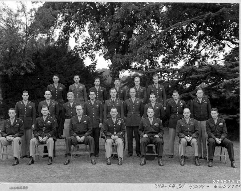 Wing and Group Commanders meeting of the 2nd Bomb Division, 8th Air Force, England.      19 September 1944    Rear Left to Right   : Col James H. Isbel   -   Col Albert J. Shower  -   Col. Luther J. Fairbanks  -   Col. Lawrence M. Thomas  -   Col. Ramsay D. Potts  -   Col.  William W. Jones                                                                                                                                                                                                                                                                                                                                                                                                                                                                                                Middle Left to Right  : Col. Lorin L. Johnson  -   Col. Eugene H. Snavely  -   Col. Ezekiel W. Napier  -   Col. Frederic H. Miller  -   Col.  Leland G. Fiegel  -   Col. Gerry L. Mason  -   Lt. Co.l Roy B. Cavines  -   Lt. Col. Everett W. Stewart  -   Lt. Col. Claiborne H. Kinnard                                                                                                                                                                                                                                                 Seated Left to Right  :   Col. Jack W. Woo  -   Brig. Gen. Leon W. Johnson  -   Brig. Gen. Walter R. Peck  -   Maj. Gen. William E.  Kepnel  -   Brig. Gen. Edward J. Timberlake  -   Brig. Gen. Jesse Auton  -   Col. Milton W Arnold.