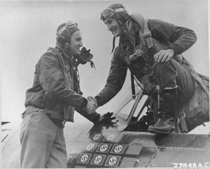 ENGLAND-Lot of things happened to Francis S. Gabreski, Oil City, Pa., on 25 January 1944. Seen here stepping out of his 8th Air force Thunderbolt on that day, he scored his 11th victory, reached a birthday, and was promoted to Lt. Colonel. The flier congratulating him is Major Sylvester V Burke, Dumont MN.  NARA Ref 342-FH-3A12139-27448AC
