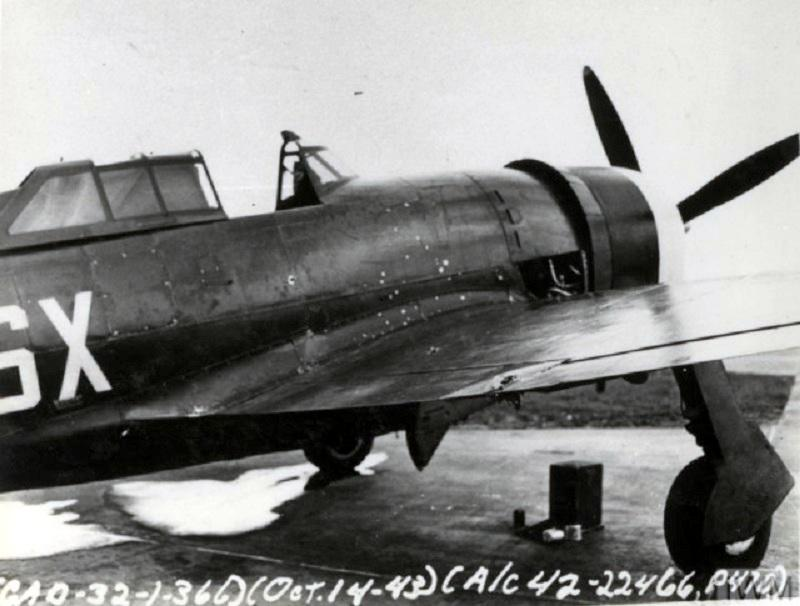 A P-47D Thunderbolt (SX-M, serial number 42-22466) of the 352nd Fighter Squadron, 353rd Fighter Group that landed poorly on a hardstanding at Metfield airbase on the 14th of October 1943 after being righted and put back on its wheels. The tear in the wing was damage caused in the landing.  Official caption on image: