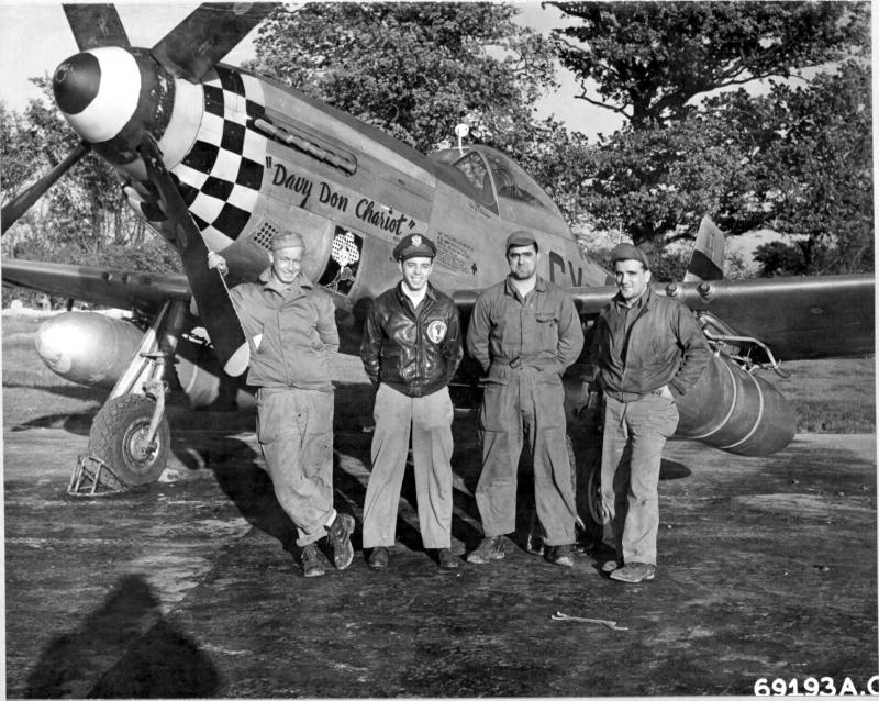 Captain Gordon S Burlingame and his ground crew of the 352nd Fighter Squadron, 353rd Fighter Group, poses beside their North American P-51