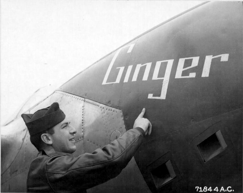 1st Lt Lee S Ayoub, 383rd Ftr Sq, 364th FG. Officially credited with 1.5 confirmed aerial victories. Ayoub points to the nose art on the right gun bay panel of his P-38J, serial 42-68043 (coded N2-D).