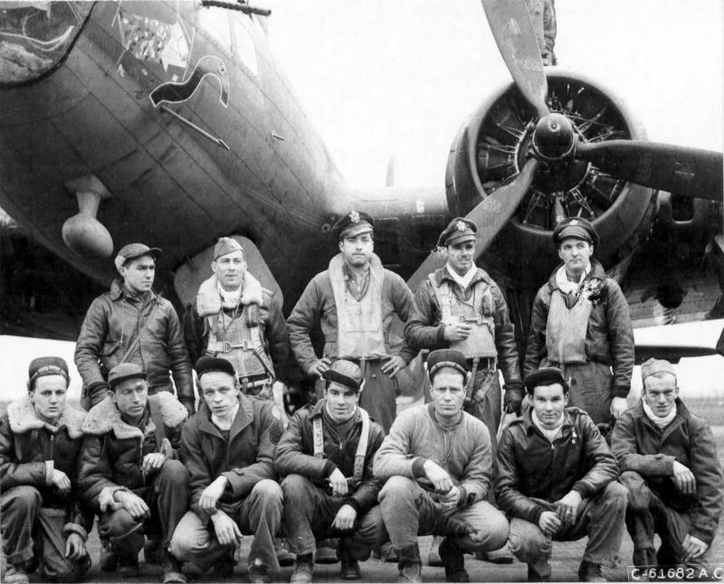 Captain Shulstad and lead crew on bombing mission to Brunswick, Germany, pose in front of a Boeing B-17
