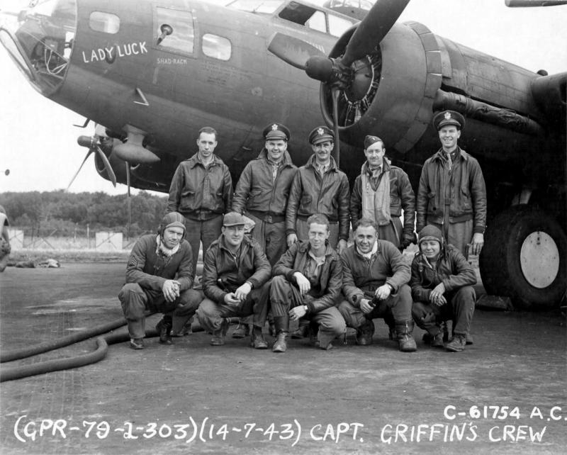 Captain Griffin and lead crew on bombing mission to Villa Coublay, France, beside Boeing B-17,