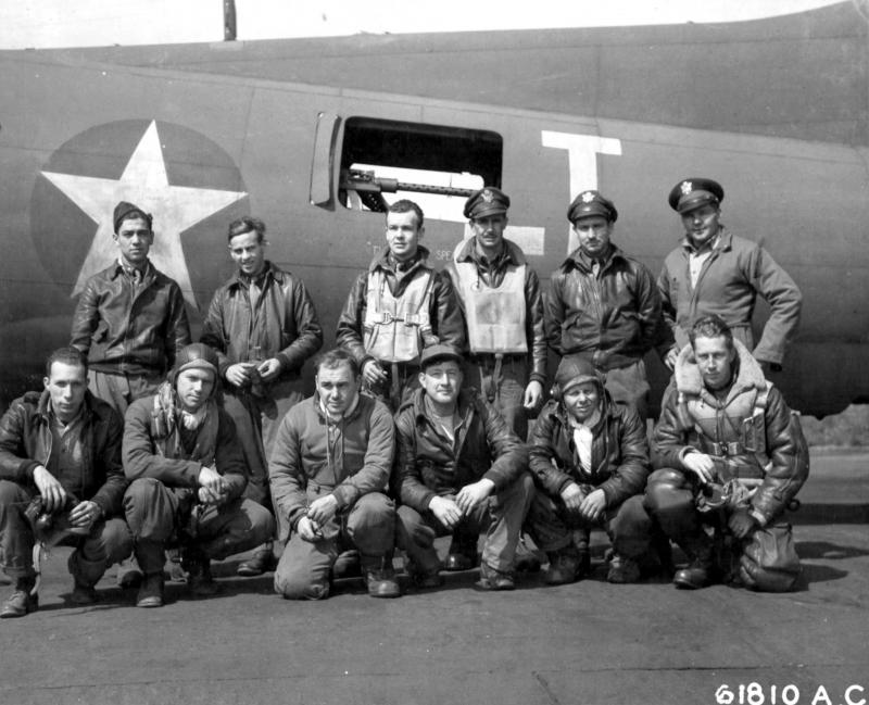 Lead crew on bombing mission to Huls, Germany pose In front of Boeing B-17 Flying Fortress. 303rd Bomb Group, England. 22 June 1943.