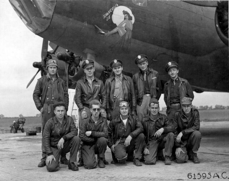 Lt Cogwell and crew of the 360th Bomb Squadron, 303rd Bomb Group based in England, pose in front Boeing B-17