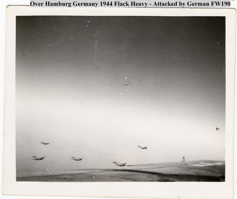 Photo taken by W.C. Hunter from plane 44-8331 in position B08, on mission to Hamburg - October 25, 1944.  Carrying 250 lb bombs to oil refinery  FW 190 attacking formation pictured at right side.