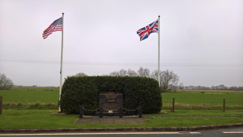 Roadside memorial to the service of the 401st Bombardment Group (H) at Deenethorpe airfield, Station 128. The location is latitude 52.495456, longitude -0.587618, and is approximately 140 yards from the southern end of the NW-SE runway.