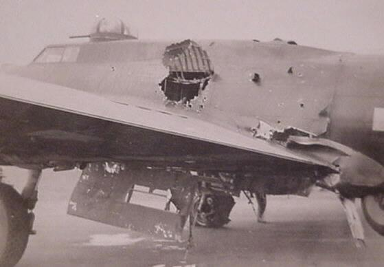 """Marvin Otto, 100th Service Group.      A B-17 that returned from a mission to Berlin had a large """"flak"""" hole in the left side of the fuselage. The radio operator's compartment had been totally destroyed and the radio operator blown out of the aircraft. One bomb bay door had been blown away. The aircraft landed with one flat tire and the ball turret guns pointing downward dragging on the runway. One bomb had not released over the target and was jammed in the wreckage of the bomb bay area. While fuel leaked from the aircraft and sparks emitted from the electrical system, Marvin disarmed the bomb and removed it from the aircraft. For his actions he was awarded the Soldier's Medal."""