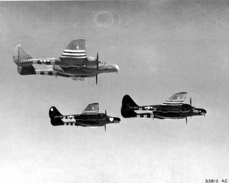 First pictures of the P-61 Black Widow, night fighter of the 9th AF, in flight over France. Use of these twin tailed twin motored high performance night fighters in the European Theatre of Operations was recently revealed after they had proved themselves in combat. They are being used for night patrols by the 9th AF defence command, commanded by Brig Gen Ned Schramm.  - P-61A's 42-5536 'Husslin' Hussey', 42-5564 'Jukin' Judy' and 42-5573 'Lovely Lady' of 422nd Night Fighter Squadron, 9AF.