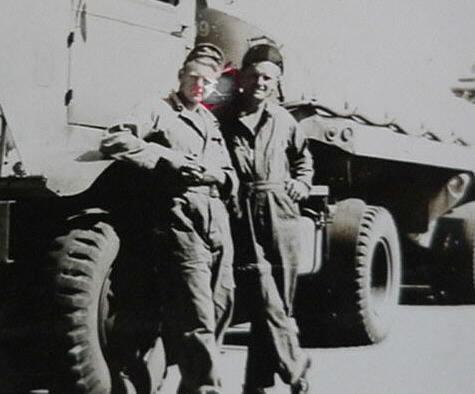 Corporal Ervin C. Stamp on the right,  as a heavy equipment driver at 20th Fighter Group, Kings Cliffe, England.