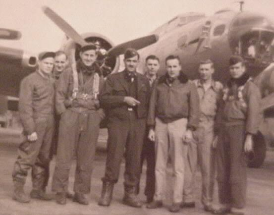 Sydney Thomas and crew at Alconbury, England. Syd, Weather Officer, is on the right.