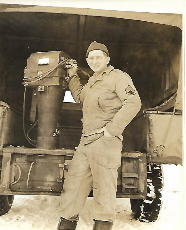 SSGT Thomas J. Fahy with one of the  cameras that would be installed in a B-24 to take strike photos