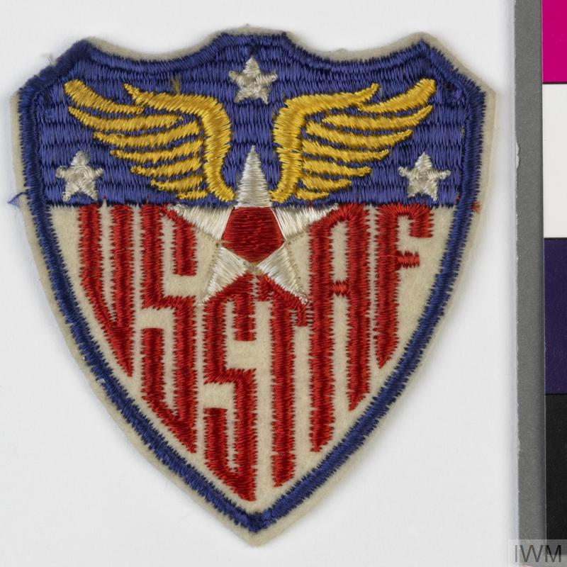 Second World War higher formation badge for the United States Strategic Air Forces in Europe (USSTAF). The shoulder sleeve insignia was approved by a US War Department radiogram dated 21 December 1944 and formal approval by the Quartermaster General was granted on 27 December 1944. The Command was formed on 1 January 1944 at Bushey Park, England under Lieutenant-General Carl Spaatz. It was administratively responsible for all US Army Air Forces in the UK and later for operational control of the 8th and 15th Air Forces.  © IWM (INS 7307)