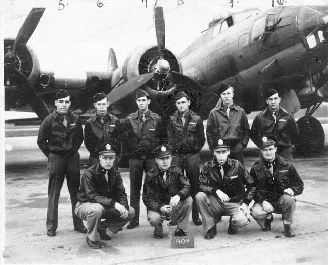 Crew of Bottled in Bond (#42-102584) 94th Bomb Grp, 332nd Bomb Sqd. Kneeling, left to right: Tom Williams, pilot, Edwin (Eddie) Waite, co-pilot, Joe Davis, navigator, Lewis Ranck, bombardier Standing, left to right: Kenneth McLean, engineer, Wayne Waters, waist gunner, Herb Schocket, radio operator, Casimir Skomski waist gunner, JW (Smitty) Smith, tail gunner, Jerry Pasquale, ball turret gunner.   Aircraft lost 05-12-1944 on mission to Brux oil refineries.  all members of crew survived and were taken as POWs Obtained this photo in 2007 after speaking with surviving crew member Edwin Waite, co-pilot on Bottled In Bond on the mission over to Brux, on the day the plane was downed