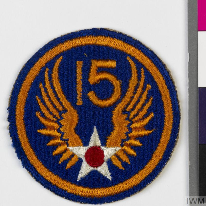 Second World War formation badge for the United States 15th Air Force (United States Army Air Force). The shoulder sleeve insignia was approved by the US Quartermaster General on 19 February 1944. Formation note: the 15th Air Force (US Army Air Force, Fifteenth Air Force) was formed on 1 November 1943 at Tunis in North Africa and moved to Italy on 1 December. The Force was disbanded on 15 September 1945 having participated in twelve campaigns.  © IWM (INS 7304)