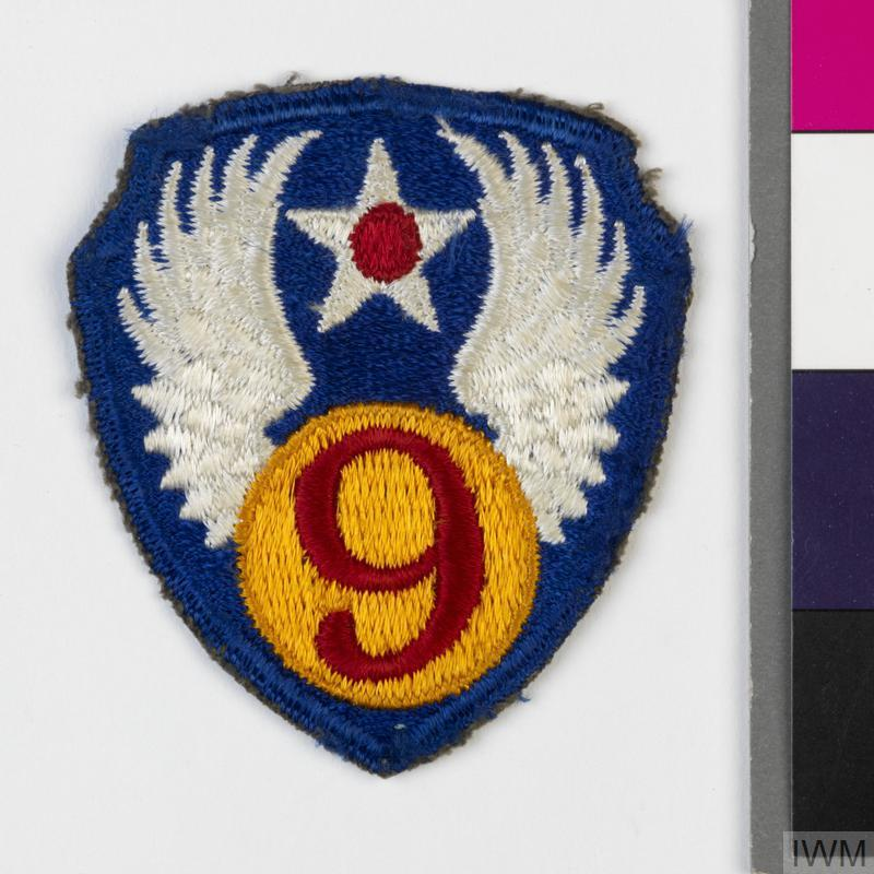 Second World War formation badge for the United States 9th Air Force (United States Army Air Force). The shoulder sleeve insignia was approved by the US Quartermaster General on 16 September 1943. Formation note: the 9th Air Force (US Army Air Force, Ninth Air Force) was formed on 8 April 1942 at the New Orleans Army Air Base in Louisiana. The Force served as the US Army Middle East Air Force. Medium bombers and fighters of 9th Air Force supported the British 8th Army (Eighth Army) across North Africa. It served in the Italian campaign and was transferred to England in October 1943 where it provided tactical support for the campaigns in North West Europe. It was disbanded 2 December 1945.