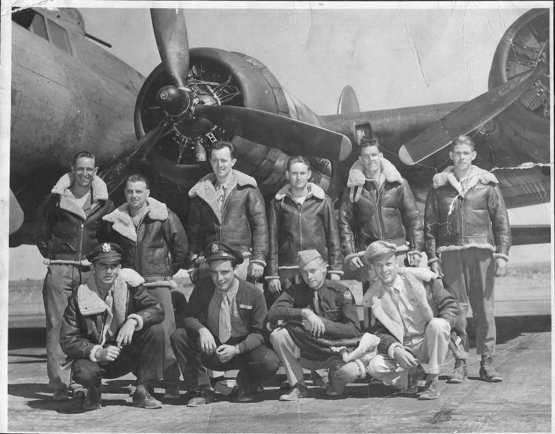 Technical Sergeant John J. Mulchrone, Radio operator / Gunner, 92nd Bomb Group, with his crew. John is the third from the left in the back row.