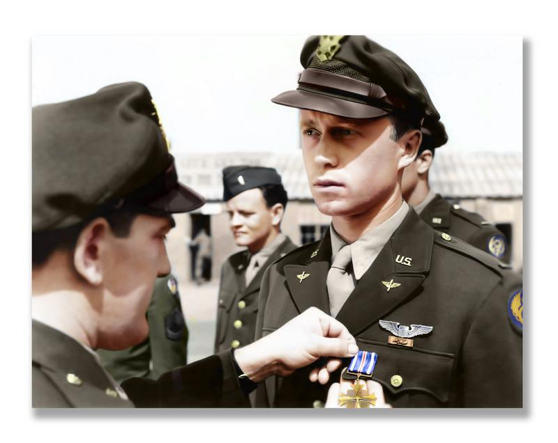 Lt. Ernest Anders Erickson receives the Distinguished Flying Cross presented to him by Colonel Karl Truesdell Jr. at Horham Airfield June 1944