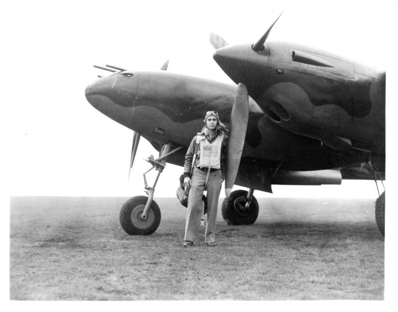 1st Lt. Robert W. Ahern Jr. with his plane, a P-38.