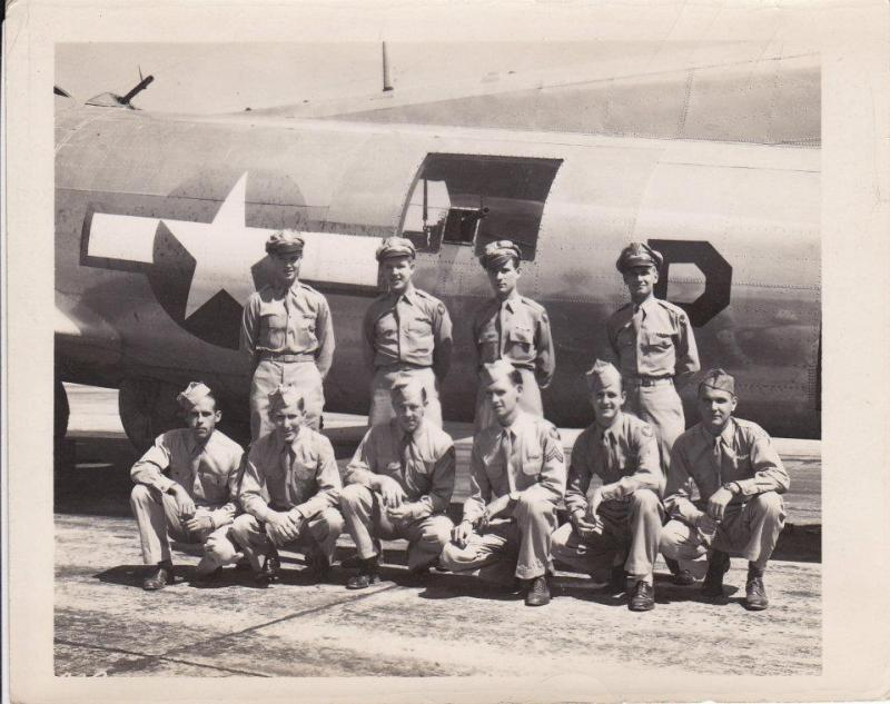 Unsure if this is under Pilot Oliver Smith or John Edelman. My grandfather, Peter Brennan, togglier in the 388th Bomb Group in the 561st Squadron in the 8th Air force.  (Peter Brennan on bottom row, far right- on the end)
