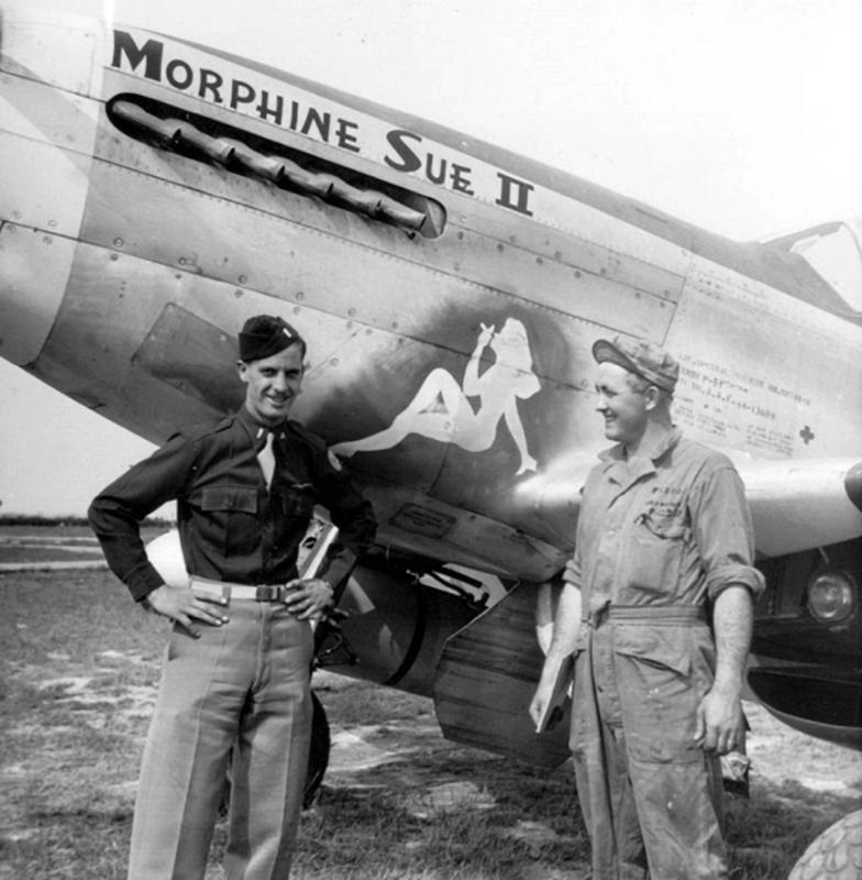 Lt. Russ McNally and crew chief S/Sgt. Cyril Monnier stand by the artwork on their P-51D Mustang named