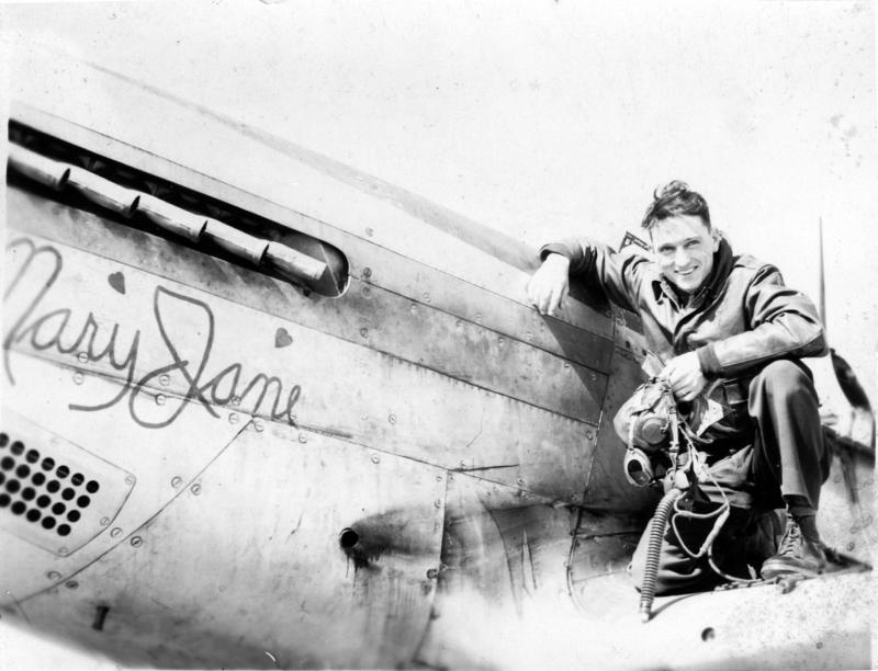Capt. Charles V. Cunningham of the 370th Fighter Squadron, 359th Fighter Group with a P-51 Mustang nicknamed