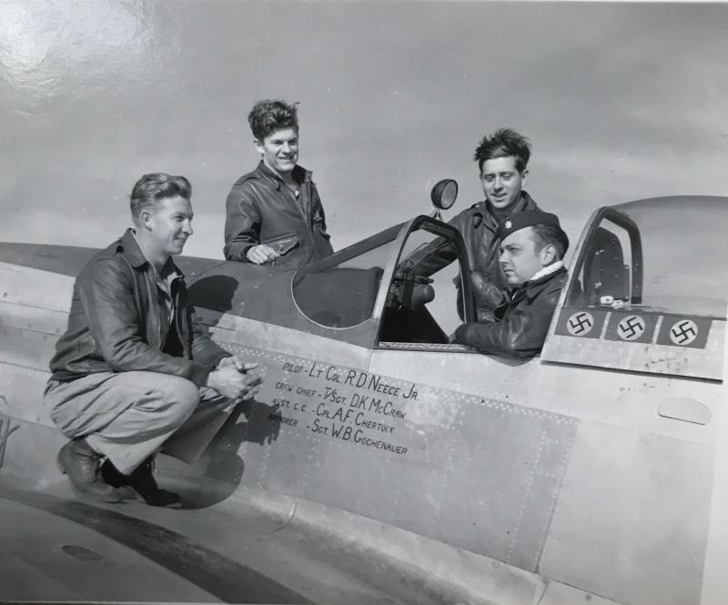 Lt. Col. Richard D. Neece, Jr. in cockpit of his p-51, with his flight crew, at Honington Air Base in July 1944.