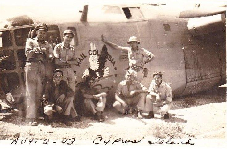 B-24D -  'Hail Columbia'   -  After Crash Landing at Nicosia, Cyprus   -   Aug 1, 1943.   From left :  Lt. Harry Korger/ Bombardier  -  Lt. Norman Whalen Navigator/nose gunner  -  kneeling, second from right, 1st Lt. Raymond Hubbard/ radio operator/ gunner, SSgt. Harvey Treace/gunner, TSgt Clarence Weckesser/ Engineer/ top turret gunner, SSgt. Neville Benson/waist gunner, SSgt.   Joseph LaBranch/ gunner, SSgt. Frederick Leard/waist gunner .  The next morning after the Ploesti mission, Monday August 2nd, 1943.