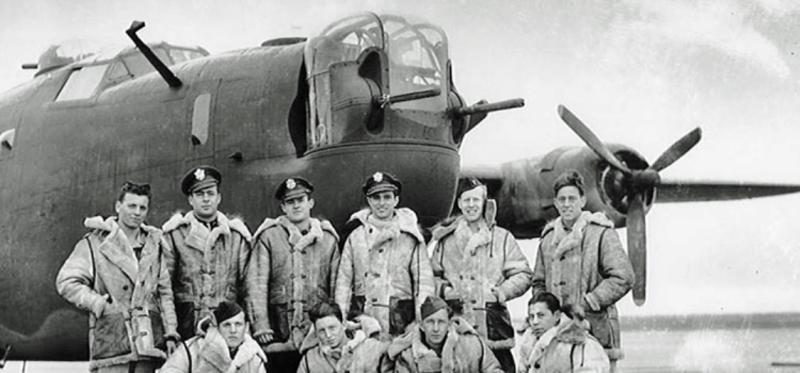 The B-24H Liberator  -  42-94812 - LITTLE WARRIOR, shown with Pilot John Jay Oling  - standing third from right -  at Mountain Home, Idaho, before flying 42-94812 to the UK. Lt.  John Jay Oling from the 490th Bomb Group, the 850th Bomb Squadron  confirms that he flew this plane to England. This photo was made before Lt. Oling and the crew decided on and painted the name they wanted on 42-94812.  At no time was 42-94812 ever called, LITTLE LAKASSAKY. The crew did want to put on a somewhat risqué name, but their concept was squashed as being too bold. The crew then came up with the LITTLE WARRIOR design which was quickly approved. The crew hired a sergeant to paint the design on the nose. It turned out so poorly that Lt. Oling removed it and repainted the nose art himself. It remained unchanged until the day that Lt. Hansen's crew went down with the plane. The Crew are  Back Row L-R Ralph D.  Sanderson - Gunner,  John V.  Hook  - Navigator,  Fred I. Griffith - Copilot,   John Jay Oling - Pilot,  Richard H. Tausch - Bombardier,  John J. Hettrich - R.O. Front Row, L-R: Stanley    Novak - Engineer,  Carl  W.    Johnson - Gunner,  Harold A.  Hutt - Gunner, Jose Molinar  - Gunner