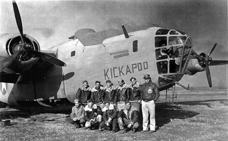 B-24D -  the KICKAPOO with crew and Pilot Lt. John S. Young on far right before the mission to bomb Ploesti, 1943.  John Young and his regular crew member's lives were spared when Group Leader Col. John R. Kane reassigned them to fly with him in HAIL COLUMBIA on Operation Tidal Wave over Ploesti.    -     KICKAPOO  crashed and burned on takeoff  for the Ploesti mission, killing the two replacement pilots and all but two of it's replacement crew.  Lt Russel Polivka and SSgt Eugene garner, gunner.   -   Aircraft Destroyed  -  Lete, Libya  -  1 Aug 1943                                                                                                                                                                                                                                                                                                                                                                                                                                                                                                                                                                                                                                              KICKAPOO's reassigned crew for the Ploesti bombing mission :  ---                                                                                                                    1st Lt. Robert J. Nespor - Pilot - (KIA) - Died two weeks later from his burns 2nd                                                                                                  Lt. John C. Riley - Co Pilot (KIA) Detached Service from 93rd BG 2nd Lt. Russell W. Polivka - Navigator (WIA) D.S. from 93rd BG T/Sgt. Vaun D. Wenrich -Engineer/Top Turret (KIA) D.S. from 93rd BG                                                                                                         T/Sgt. Armand R. Massart - Radio Op (KIA) D.S. from 93rd BG S/Sgt. George W. Lawlor - Gunner (KIA) D.S. from 93rd BG                                             