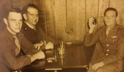 Sgt. Bible (on left next to the wall )and his crew celebrate VE Day at the local Pub in Mendlesham ,UK . Pictured on the right his Pilot Lt. Stephen Peters.