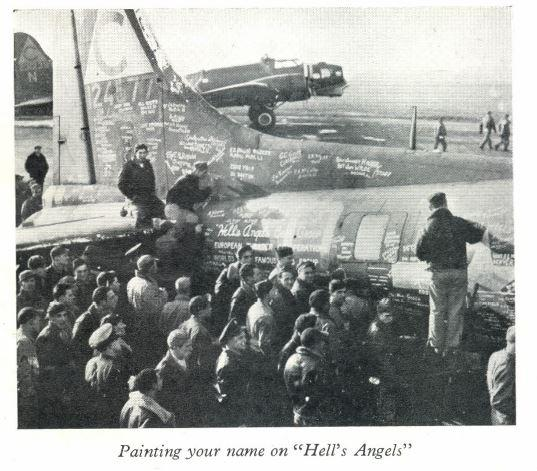 Members of the 303rd Bomb Group paint their signatures on B-17 Flying Fortress (serial number 41-24577) at Molesworth.   Construction worker, Kenneth Elsden is in the bottom right hand corner.