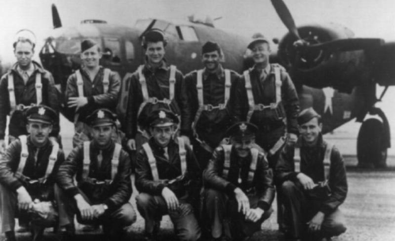 A bomber crew of the 93rd Bomb Group, led by  First Lieutenant Roy C Harms, with their B-24 Liberator (serial number 42-40781)