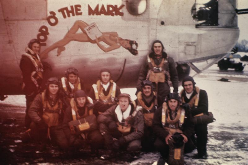 Nose art by Albert Knowles 458 BG. A bomber crew of the 458th Bomb Group with their B-24 Liberator (serial number 42-51110) nicknamed
