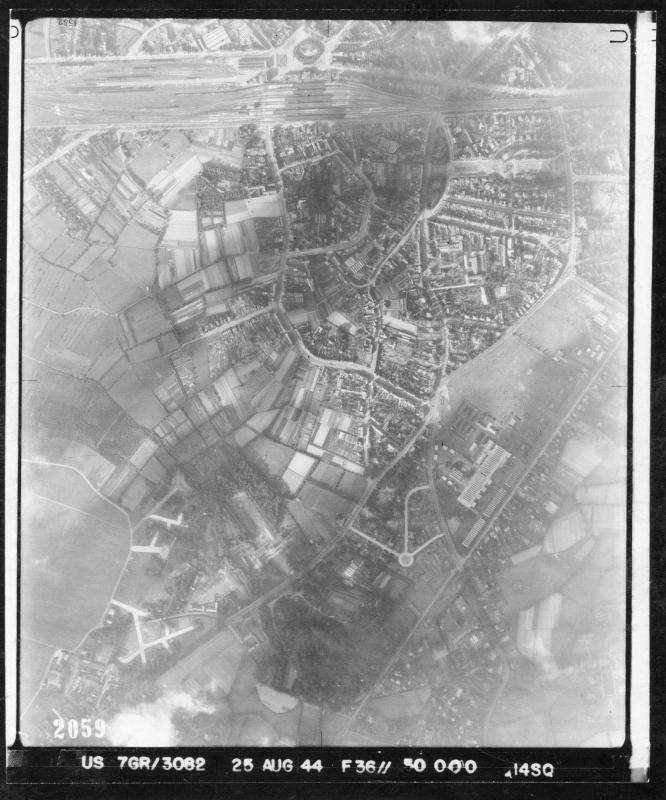 Aerial photograph of airfield Sint-Denijs-Westrem & barracks at 'De Sterre' near Ghent, and railway station Ghent Sint-Pieters (Belgium) 25th Aug 1944 - 14th Photo Squadron of the 7th Photgraphic  Reconnaissance Group Liberation Ghent (BE) Sept 1944