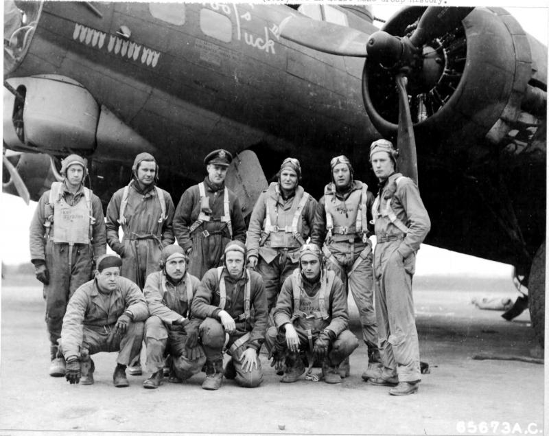 The first crew of the 401st Bomb Group to return to the home base in England after a raid on Berlin, Germany, pose beside their plane - the Boeing B-17 'Fool's Luck'. They are, (Left To Right) Back Row: F/Sgt. Jesse H. Lehr, Radio Operator, S/Sgt. Pete D. Henderson waist gunner, 1Lt Donald M Anderson Bombardier, Capt Jere Maupin co-pilot, Capt James J Goodman pilot, 1Lt Robert J Ramsey tail gunner. Front Row: T/Sgt John O Farmer ball turret gunner, S/Sgt Burton A Markle waist gunner, T/Sgt Foster E Dewees top turret gunner and 2Lt Frank P Fraoli navigator. 6th March 1944.