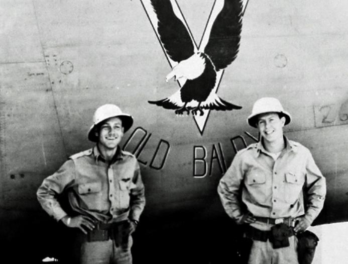 B-24 42-40102 'Old Baldy' nose art flanked by Navigator Worthington A. Franks (L) and Bombardier Joseph E. Finneran (R)