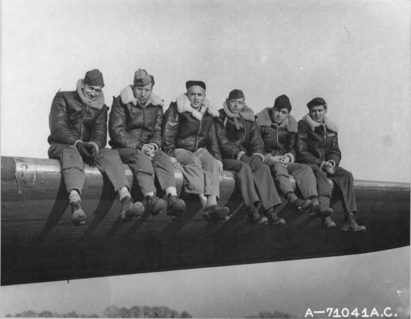 A Crew Of The 379Th Bomb Group Poses Beside A Boeing B-17