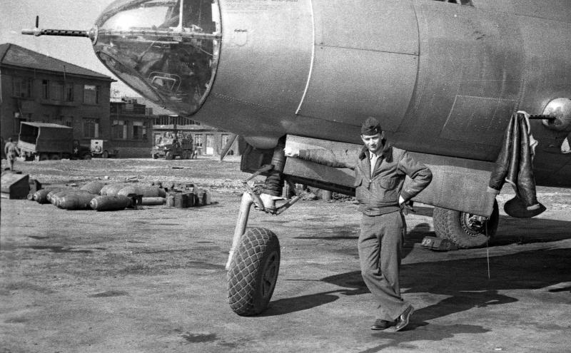 1LT Jasinowski [first name unknown, no further details] copilot of C-47 43-49203 Li'L Woman the 320th BG's courier aircraft - this image is from a roll of negatives taken in and around the Dijon-Longvic Airfield, France on or before April 1944 - Note: This photo was scanned in 2004 from 35mm negatives discovered the Taylor Family collection. Damage due from improper handling and storage.